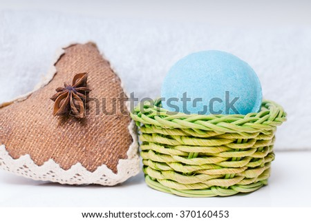 Beauty spa, bath bomb, aroma cosmetic soap with towel and anise. Natural aromatherapy ball for care, wellness, health, treatment, hygiene, relaxation. Relax bathroom. Object for luxury therapy - stock photo