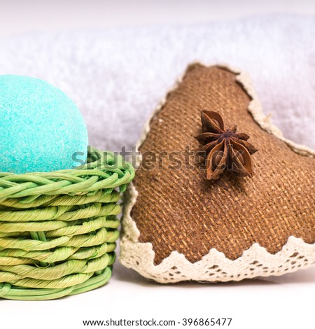 Beauty spa, bath bomb, aroma cosmetic soap with towel and heart. Natural aromatherapy ball for care, wellness, health, treatment, hygiene, relaxation. Relax bathroom. Object for luxury therapy - stock photo