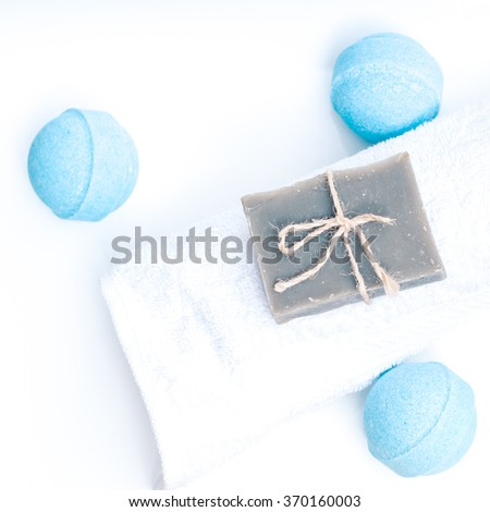 Beauty spa, bath bomb, aroma cosmetic soap with towel and soap bar. Natural aromatherapy ball for care, wellness, health, treatment, hygiene, relaxation. Relax bathroom. - stock photo