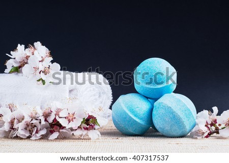 Beauty spa, bath bomb, aroma cosmetic soap with towel, flower branch. Natural aromatherapy ball for care, wellness, health, treatment, hygiene, relaxation. Relax bathroom. Object for luxury therapy - stock photo