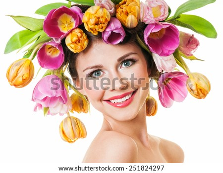Beauty Spring Girl with Flowers Hair Style. Beautiful Model woman with Blooming flowers on her head. Smile. - stock photo