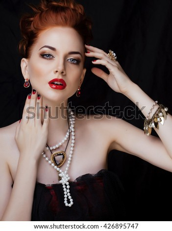 beauty stylish redhead woman with hairstyle and manicure wearing jewelry pearl close up - stock photo