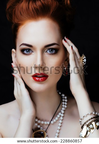 beauty stylish redhead woman with hairstyle and manicure wearing jewelry, qween ginger - stock photo