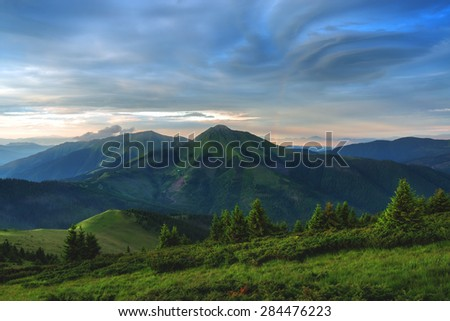 Beauty summer day in the Carpathian mountains with colorful sky. Marmarosu ridge, Ukraine, Europe.  - stock photo