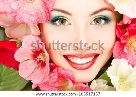 beauty summer portrait of beautiful female face with pink, red and white mallow flowers frame - stock photo