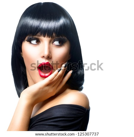 Beauty Surprised Brunette Woman isolated on White background. Beautiful Girl opening Mouth. Emotion. Red Lips and Black Nails. Hairstyle. Makeup - stock photo