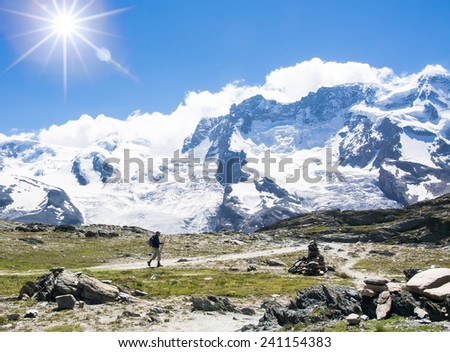 Beauty Swiss, trekking on mountain  with sunlight on blue sky - Switzerland - stock photo