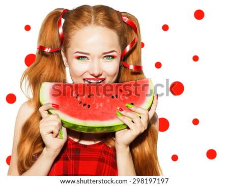 Beauty teenage model girl eating watermelon. Bright vivid makeup and manicure. Beautiful young woman holding slice of fresh ripe juicy watermelon and smiling, isolated on white background. pigtail  - stock photo