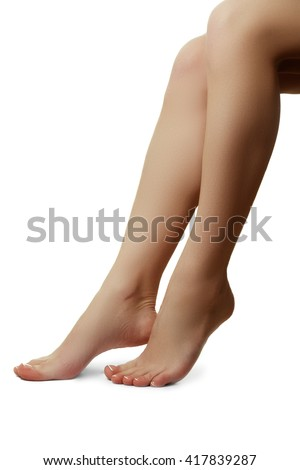 Beauty treatment photo of nice pedicured feet. Close-up shot of beautiful woman feet with French pedicure - stock photo