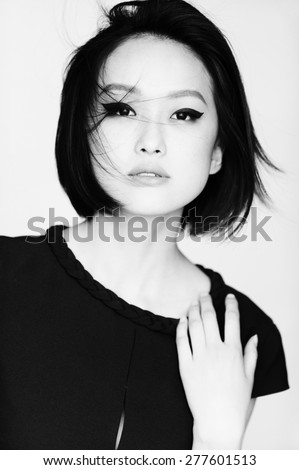 Beauty Vogue Style Fashion Model Girl. Young and beautiful asian woman on white background. - stock photo