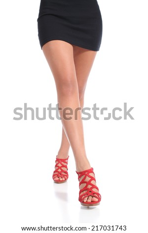 Beauty waxed woman legs walking wearing heels isolated on a white background           - stock photo