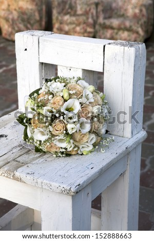 beauty wedding bouquet of roses in a bride hands. retro style - stock photo