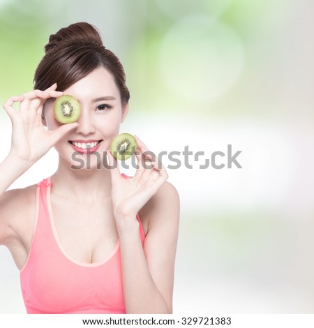 Beauty woman and Kiwi fruit - The woman is dieting healthy with nature green background, asian female - stock photo