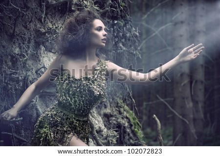 Beauty woman as a part of tree - stock photo