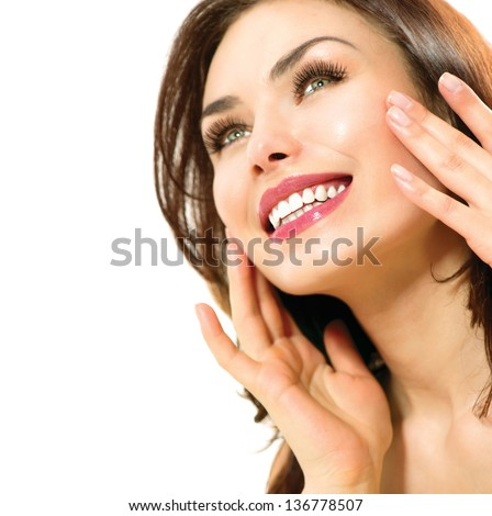 Beauty Woman. Beautiful Young Female touching Her Skin. Portrait isolated on White Background. Healthcare. Perfect Skin. Beauty Face. Makeup - stock photo