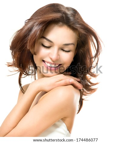 Beauty Woman. Beautiful Young Female touching Her Skin. Portrait isolated on White Background. Skincare concept. Healthcare. Perfect Skin. Beauty Face.  - stock photo