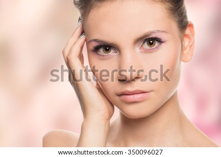 Beauty Woman face Portrait. Beautiful Spa model Girl with Perfect Fresh Clean Skin. Youth and Skin Care Concept. Isolated on a colorfull background. - stock photo