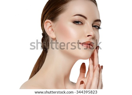 Beauty Woman face Portrait Girl with Perfect Fresh Clean Skin female looking at camera smiling.Youth and Skin Care Concept.Cheerful girl is touching her cheeks pleasure.Isolated - stock photo