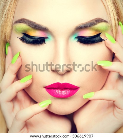Beauty Woman face Portrait with Vivid Makeup and colorful Nail polish. Colourful nails. Fashion Girl close up. Bright Colors. Manicure Make up. Smoky eyes, long eyelashes. Rainbow Colors  - stock photo