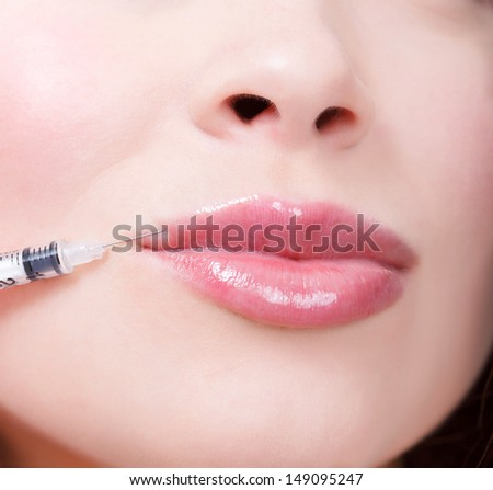 Beauty woman giving botox injections.  - stock photo