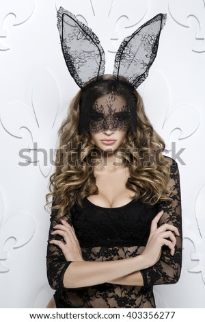 Beauty woman in bunny mask in studio  vertical - stock photo