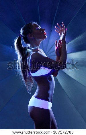 Beauty woman in dance with ultraviolet make-up - stock photo