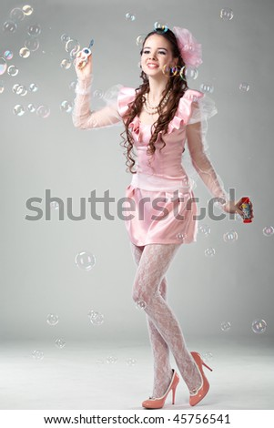 beauty woman in pink dress with soap bubbles - stock photo