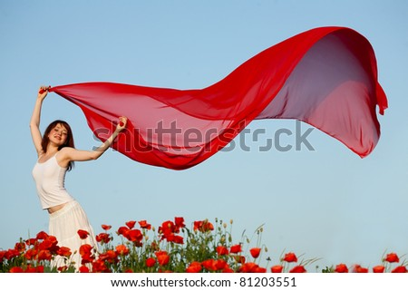 beauty woman in poppy field with tissue - stock photo