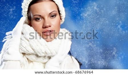 Beauty woman in the winter scenery - stock photo