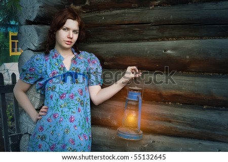 beauty woman in vintage dress on wooden background - stock photo