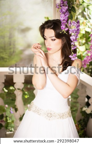 Beauty woman in white dress. Bride, wedding in garden. Brunette - stock photo