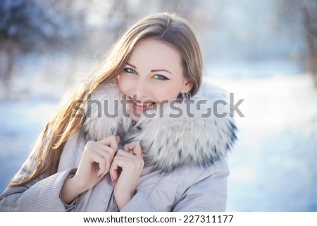 Beauty woman in winter forest - stock photo