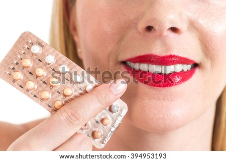beauty woman mouth with red lipstick near blister packs of pills  - stock photo