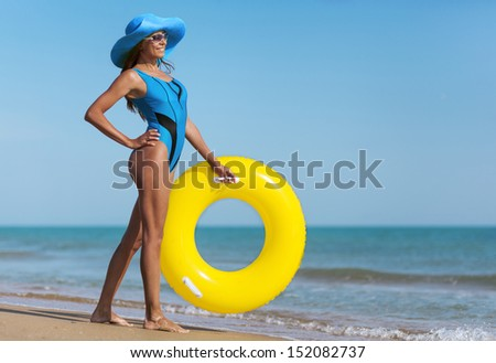 beauty woman on sea beach under blue sky - stock photo