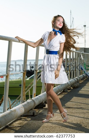 beauty woman on sea with ship - stock photo