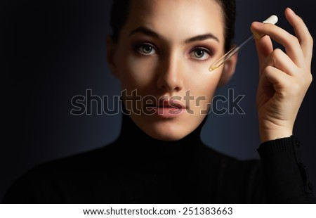 beauty woman on the dark background - stock photo