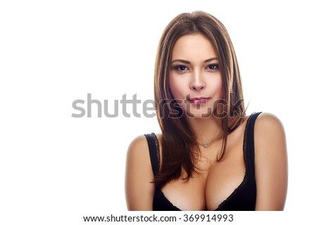 Beauty woman portrait posing in black bra showing her ample cleavage, isolated on white background - stock photo
