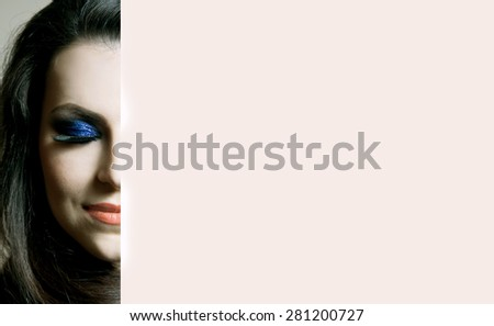 Beauty Woman Portrait. Professional Makeup for Brunette with Blue eyes - Red Lipstick, Smoky Eyes. Beautiful Fashion Model Girl. Perfect Skin. Make up. Isolated on a White Background. Part of face - stock photo