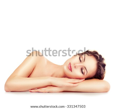 Beauty Woman Relaxing and Lying Down. Spa Girl. Sleeping or Resting Female isolated on White Background. Relax. Relaxation. Beauty Salon - stock photo