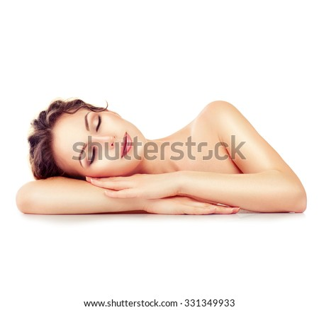 Beauty Woman Relaxing and Lying Down. Spa Girl. Sleeping or Resting Female isolated on White Background. Relax. Relaxation. Beauty Salon. Space For Your Text - stock photo