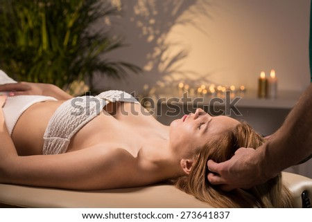 Beauty woman relaxing during pleasant head massage - stock photo