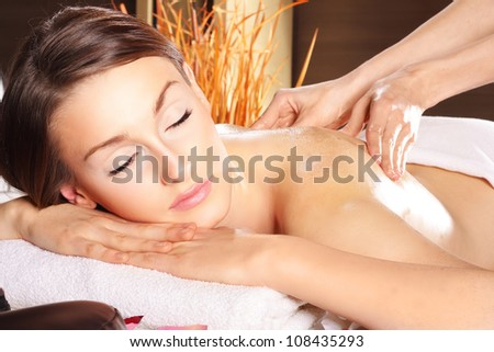 Beauty woman relaxing in spa. Hand massage. - stock photo