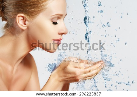 Beauty woman skin care, washing with splashes and drops of water - stock photo