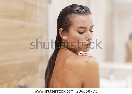 Beauty woman under the shower  - stock photo