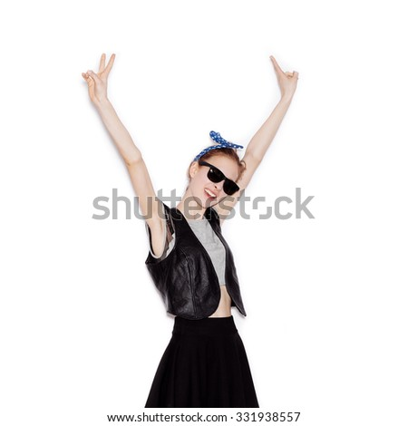 Beauty woman wearing black leather jacket and skirt having fun. Portrait of beautiful cheerful teen girl with long brown hair and clean skin. Not isolated on white background - stock photo