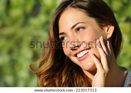 Beauty woman with a perfect smile and white tooth with a green background - stock photo