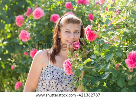 beauty woman with blossom flowers in garden - stock photo