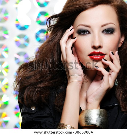 Beauty woman with bright fashion eye make-up and red lips - stock photo