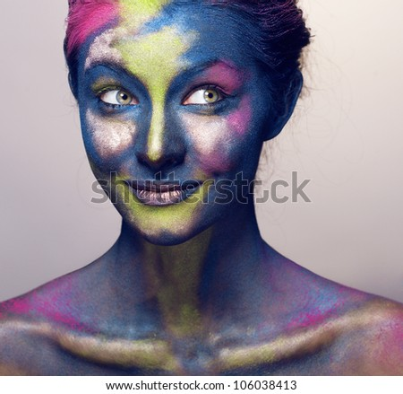 beauty woman with creative make up like Holy celebration in India - stock photo
