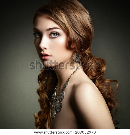 Beauty woman with long curly hair. Beautiful girl with elegant hairstyle. Fashion photo - stock photo
